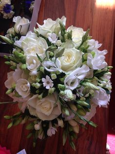 All white bouquet of roses, phlox and bouvardia