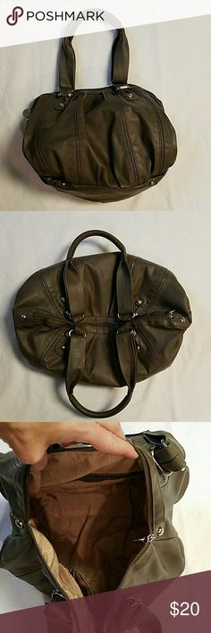 Jennifer Lopez Hobo Handbag Taupe EUC Minimal wear,  some small soil marks inside. Not pen. No rips or repairs.  Great looking bag with lots of room and pockets, pouches to organize your possessions.  Silver findings.  Zipper works well.  Color taupe in some lights it looks gray in other it's a deep beige. Jennifer Lopez Bags Hobos