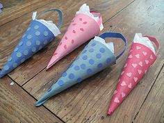 Cut construction paper into a square, fold square in half to form a triangle. Roll up triangle to form a cone and secure with tape. Tuck any excess paper down into the cone. From the piece leftover from cutting the paper into a square,