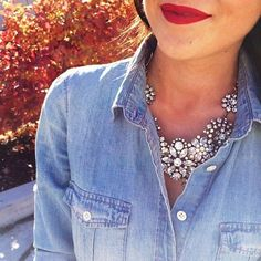 red lipstick, chambray shirt, and floral statement necklace