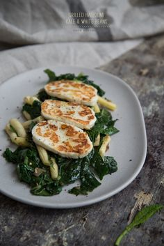 Grilled Halloumi On Kale And White Beans. If you've never tried halloumi, it's an amazing Greek cheese - delicious & substantial