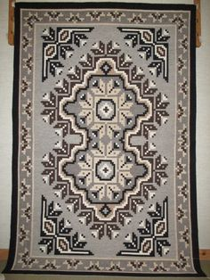 A terrific example of Two Grey Hills Navajo weaving (my personal favorite!), this rug combines traditional Navajo techniques with the medallion design imported from Oriental carpets in the late 1800's, but in a modern way.