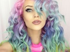 For those who have a fear of commitment, a half-toned look like this one still looks pretty fab.  Wavy tresses can make your head look like a gorgeous rainbow sea.  Match your eyeliner to your turquoise 'do and you'll look like one ...