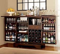 Bar Cabinet - I have this very bar in my apt. Looks like a wooded steamer trunk when it's all folded up. Got it at Crate & Barrel. LOVE IT!