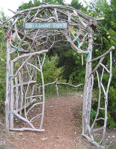 I love the homemade cedar arbors, gates, and fences that accent the gardens. This is the entry to the labyrinth and the tepee area.