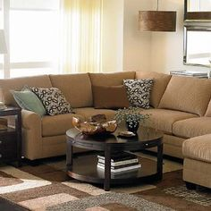 Round Coffee Table with Sectional. Exactly what we need! Safe for babies!!