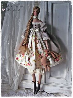 Tilda doll with Bunny Handmade doll Tilda Primitive doll Easter decor Home decor Fabric doll This cute little doll is my interpretation of a Tilda doll pattern. Doll is wearing a beige dress with puffed sleeves, decorated with cotton lace, satin ribbon and below dress she is