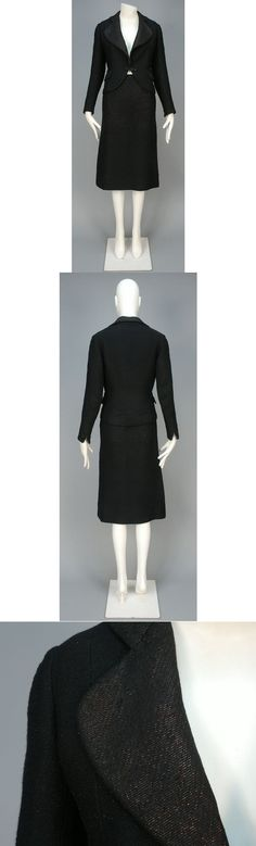 WOOL and METALLIC SKIRT SUIT, 1936. Twisted black wool yarn with red metallic threads having rounded collar, lapel and front hem, flap pockets and self button closure and cuff, matching over the knee pencil skirt. I. Magnin & Co. label. B-34, Sh-16, Slv-23, jacket L-22, W-26, H-35, skirt L-28. I. Magnin & Co. label. very good. FAMSF. $60