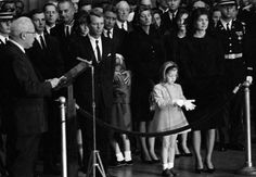 Jacqueline Kennedy stands with her daughter, Caroline, as