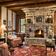 A private sitting area is located off the main entry.  This cozy space has its own masonry fireplace with birch bark detailing.  Interior finishes include tree-length white cedar with chinking, stucco, white cedar log accents and paneling.