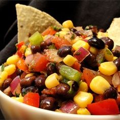 Black Bean and Corn Salsa 1 can black beans, rinsed 1 can corn, rinsed or small bag frozen corn 3 Roma tomatoes, chopped or cherry tomatoes 2 avocados, chopped ¼ c. red onion, chopped ¼ to ½ c. Fat free Italian Dressing (Kroger brand spicy Italian) 1 green pepper, chopped   Toss avocado pieces in lime juice. Combine all vegetables, add dressing and serve with corn chips
