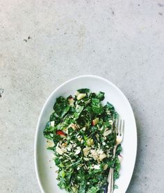 seedy, nutty kale and apple salad w/ miso tahini dressing via Seven Spoons