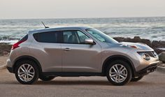 A side view of a silver 2011 Nissan Juke