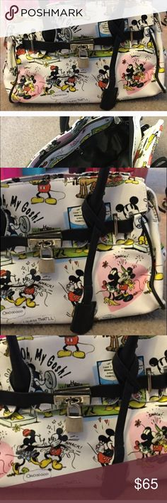 Disney. Bag. Bought. In. Disney.  New New.   Disney. Bag. It's. Mickey and. Mimi Black. Handles.   Never. Used. Handles. Are. Short.    (((Not. A. Shoulder. Bad ))) Bags Satchels
