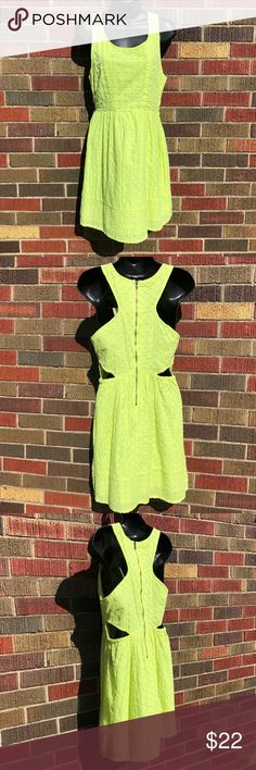 """American Eagle NWT yellow summer dress size 4 American Eagle Outfitters fluorescent yellow crochet summer dress with built in liner. Size 4. Racer back style with 17"""" zipper in back. 2 cut-outs at waistline.  New with tags. Excellent condition.  Materials: Shell- 70% Polyester, 30% Cotton. Lining- 100% cotton.  Measurements (approx): 15.5"""" pit to pit, 14"""" across waist, 33"""" shoulder seam to bottom of dress. BUNDLE SPECIAL: 15% off 3 or more items from my closet! American Eagle Outfitters…"""