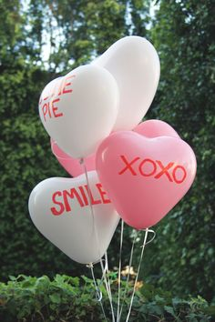 Conversation heart balloons. Personalize the messages.