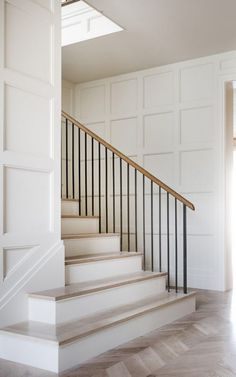 Panneled walls and a wrought iron balustrade in a Texas home by Coats Homes and Turney and Associates Architects Photo by Costa Christ Entry Stairs, Staircase Railings, House Stairs, Staircase Design, Stairways, Banisters, Spiral Staircases, Handrail Ideas, Modern Staircase
