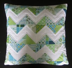 HST quilted pillow ... s.o.t.a.k handmade - really love this pillow and i have a lot of these fabrics.  maybe i'll make one for baby's room?