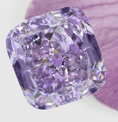 "The ""Purple Orchid"" diamond is up for auction today at the Hong Kong Jewelry & Gem Fair. This incredibly rare fancy intense pinkish purple VS2 diamond is 3.37 carats, a size practically unheard of for purple diamonds. It took Leibish & Co., the top name in fancy diamonds, four months to cut and polish this beauty.  And what, did you ask, is the starting price for this plum pièce de résistance? Only $4 million, or nearly $1.2 million per carat.  #purplediamond #yesplease! www.diamonds.pro"