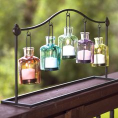 Light the room or deck in beautiful color with this colored glass and iron votive holder.   SHOP NOW >>> www.femailcreatio... #UniqueGifts #GiftsForWomen #Gifts #GiftsForAllOccassion #InspirationalGifts #Girlfriends #Sisterhood #LiveLoveShop #HomeAndGarden #Outdoorlighting #votivecandles