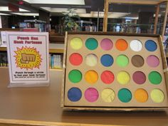"""Punch Box Book Fortunes - a cupcake carrier box with book fortunes like """"You will read a book whose title starts with L"""" or You will choose a sports book"""" on the bottom, then tissue paper squares glued on the back of the cupcake cutouts.  They punch out a circle to reveal their book fortune."""