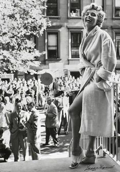 ec835278e Marilyn Monroe playing Marilyn Monroe to a crowd of press and onlookers, on  the New York set of THE SEVEN YEAR ITCH in September Photo by George Barris.