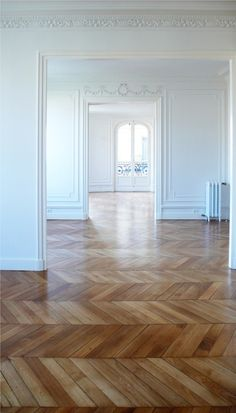 Absolutely stunning chevron wooden floor. The white walls are perfection. My ideal home!