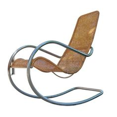 This stunning rocking chair is both simple and sexy. In the manner of Marcel Breuer this bauhaus inspired vintage steel and rattan rocking chair is ready for any modernist home. Outdoor Chairs, Outdoor Furniture, Outdoor Decor, Rattan Rocking Chair, Large Chair, Marcel Breuer, Weathered Wood, Coastal Cottage, Midcentury Modern