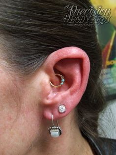Daith piercing by Ryan Ouellette. Precision Body Arts in Nashua, New Hampshire. Jewelry by BVLA.