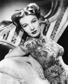 Veronica Lake movie star fashion style 40s hair rolls screen siren dress floral beaded sequins portrait