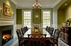 The warmth of tradition - green dining room with fireplace