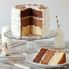 The Triple Chocolate Layer Cake combines dark, malted milk & white chocolate sponge cakes. Covered in a luscious marshmallow buttercream frosting, it is a special celebration cake Layer Cake Recipes, Best Cake Recipes, Cupcake Recipes, Sweet Recipes, Cupcake Cakes, Dessert Recipes, Cupcakes, Layer Cakes, Brownie Desserts