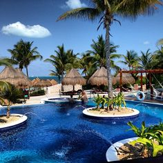www.becketttravel.com Swimming pool at Excellence Playa Mujeres Cancun, Mexico.
