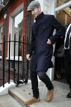 Yes, we did feature him last week, but when Becks keeps dressing this well he can't help but be included. Again, we're not sold on the newsboy hat, but that navy double-breasted overcoat (a great look for this time of year) works perfectly with suede Chelsea boots and dark denim.