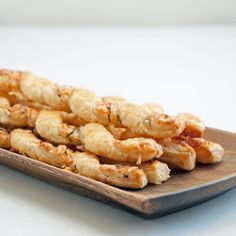 Earthy gruyere, flaky puff pastry, and the fresh flavors of rosemary and thyme combine forces in these addictive and eye-catching cheese straws.