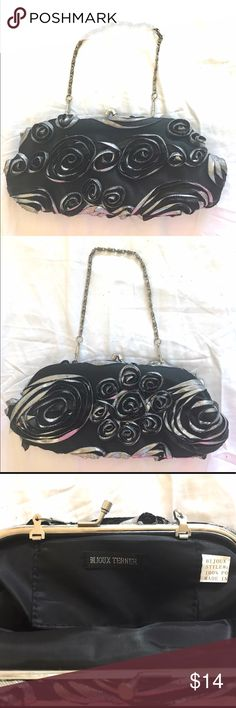 Bijoux Terner Silver Black Rose Clutch Purse This Bojoux Terner clutch is perfect to hold any loose items so you can make sure your hands won't be full during a night out in the town. Never used. Silver roses with black fabric and mesh. Removable chain strap. Bijoux Terner Bags Clutches & Wristlets
