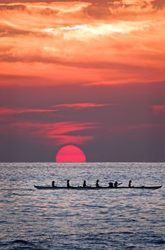 Hawaiian women paddling a canoe home at sunset. Gorgeous!