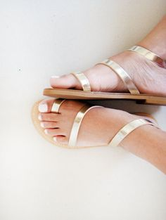 Gold greek sandals that'll go perfectly well with your white Summer dress.