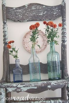 vintage bottles with orange flowers