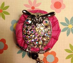 Crystal owl on pink fabric retractable badge reel on Etsy, $12.00