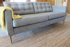 Tufted heather grey Karlstad sofa...must check out this great Ikea hack!