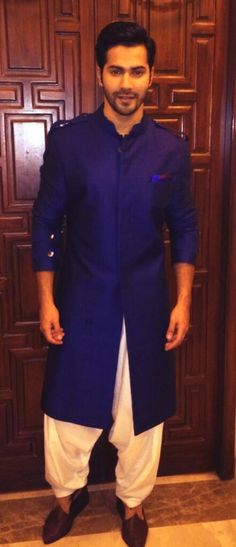 # Bollywood stylish actor varun dhawan in dashing blue pathani style.