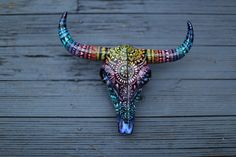 Hand Painted Resin Bull Skull. Painted with acrylic paint pens and sealed in a glossy acrylic top coat. Made by SaltyHippieArt