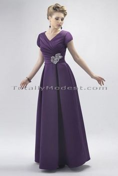 Selena - Love the tulip sleeves and boxed pleating on the skirt. And the back is finished with buttons over the back zipper.