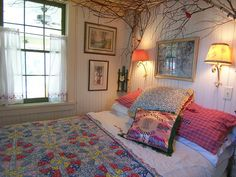 Creative use of birch branches as a bed headboard/canopy....