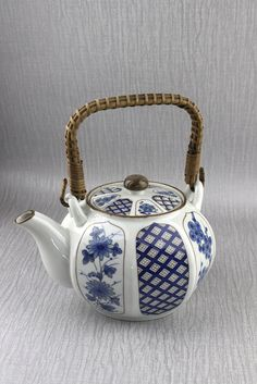 Blue and White Oriental Cherry Blossom with Wicker Handle Tea Pot TeaPot Asian Teapots, Oriental, Chocolate Pots, Shades Of Blue, White Ceramics, Cherry Blossom, Tea Party, Wicker, Tea Cups