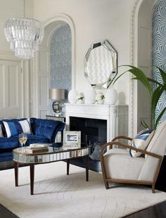 Go glamorous with an Art Deco interior  The Great Gatsby film is due out this summer, and 1920s-style is making waves on the high street. Get the look in your living room with decadent reflective accessories and furniture - mirrored trinkets, metallic vases and silvery surfaces. This look is all about luxury, so choose a sumptuous velvet sofa, a glittering crystal chandelier and dark wood furniture, then paper alcoves with ornate Art Deco style patterns.