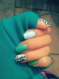 A very cozy and homey fall nail art design featuring aquamarine and white matte polish topped with simple leopard prints.