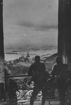German soldiers watch the Navodnitsky Bridge burn from the Kiev monastery, 1941.