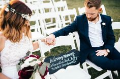 honoring deceased loved ones at a wedding by reserving a seat for them with a custom chalkboard sign... priceless
